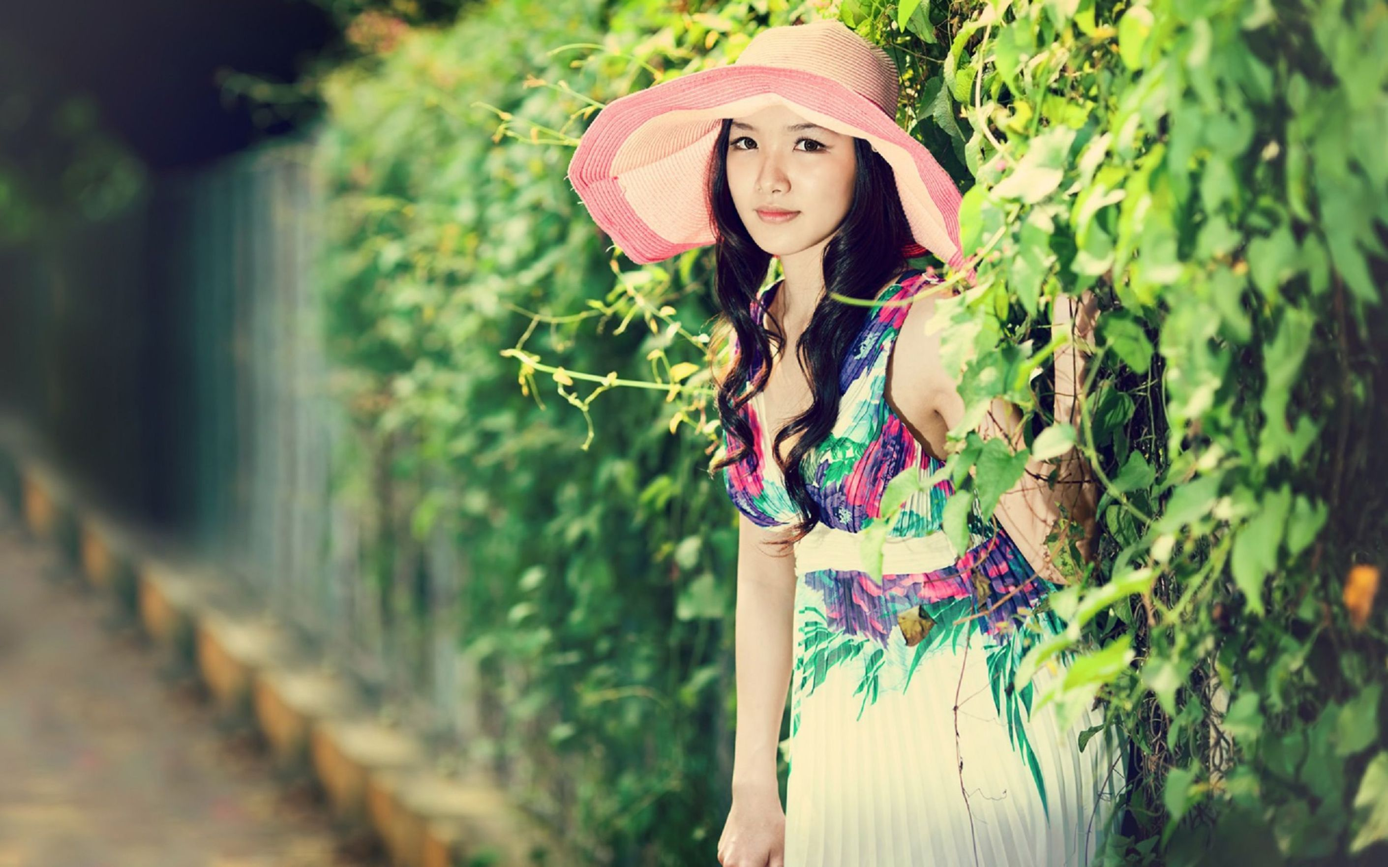 Download free HD Asian Girl Hiding In Green Fence Wallpaper, image