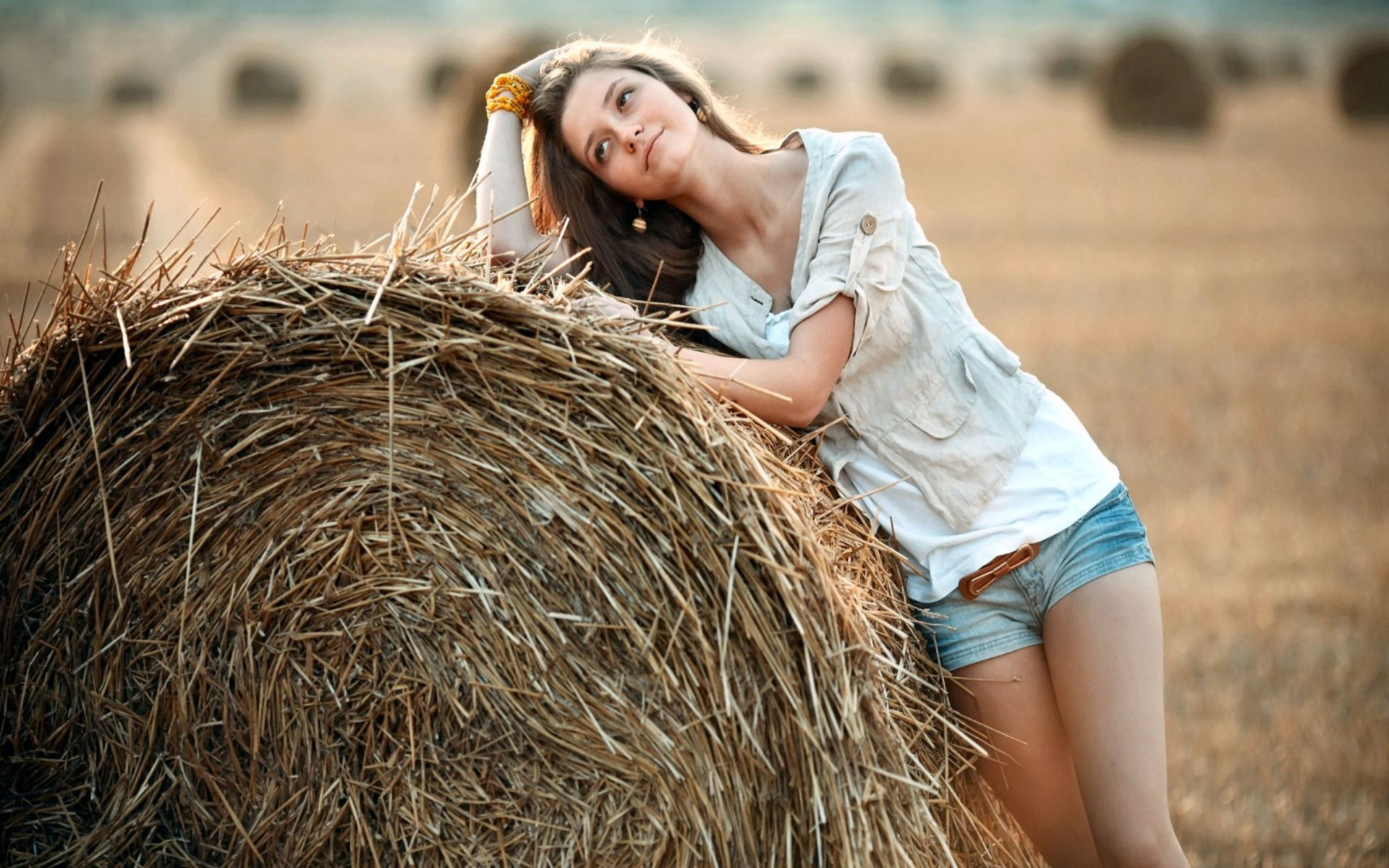 Cowgirl in a Hay Field Wallpaper