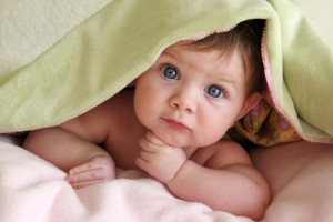 Cute Kid Under Blanket Wallpaper