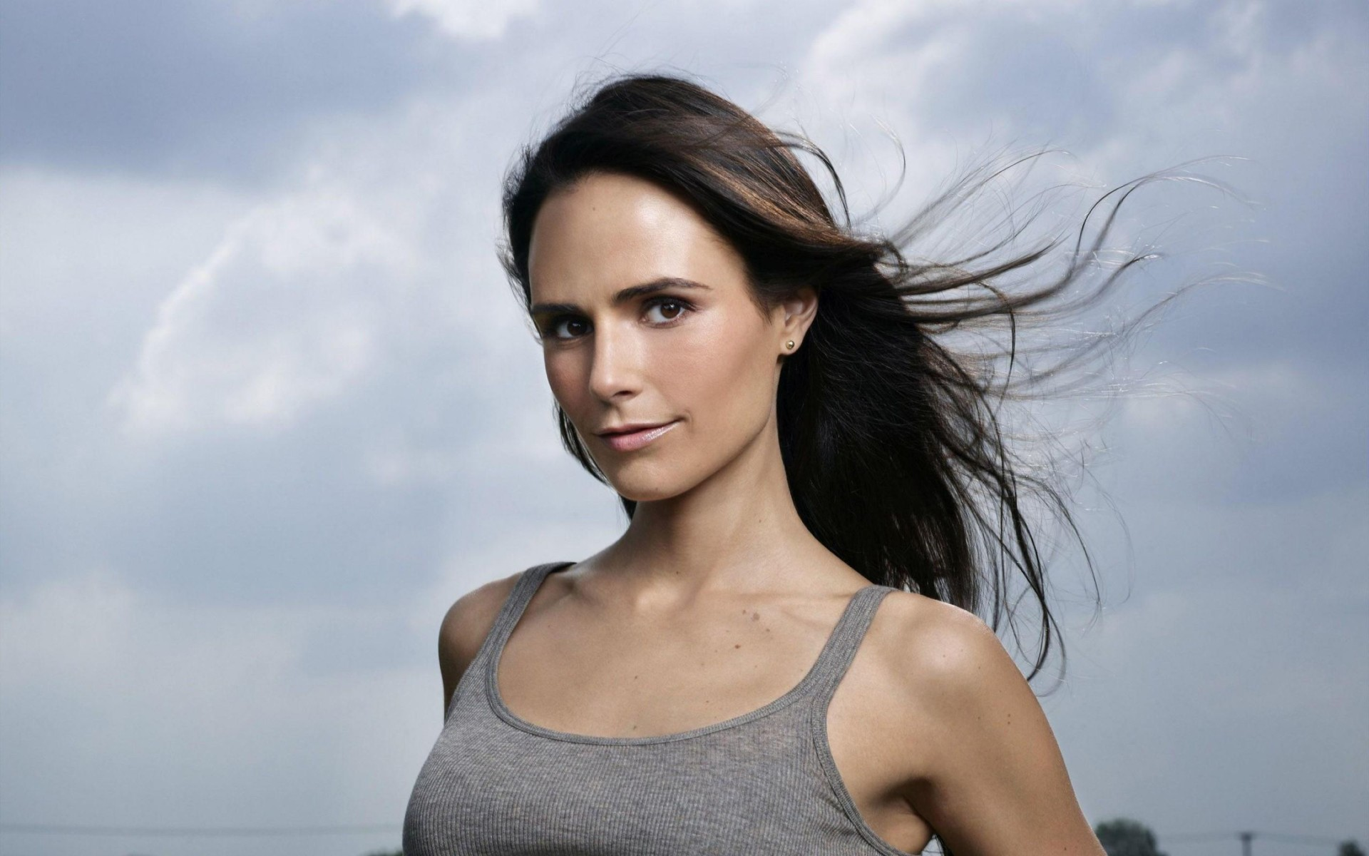 Jordana Brewster With Her Hair In The Wind Wallpaper