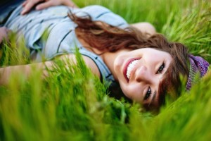 Smiling Girl In Grass Wallpaper